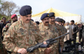 Chief of Army Staff General Raheel Sharif inspecting one of the competitors seeking to secure Pakistan's standard rifle requirement. Photo credit: ISPR