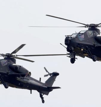 A pair of Pakistan's Z-10 attack helicopters flying past a parade venue as part of Pakistan's national day parade on 23 March 2016. Photo credit: Reuters.