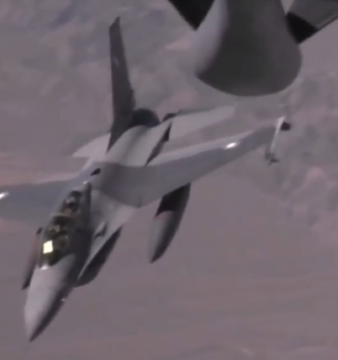 A Pakistan Air Force F-16B refueling mid-air with the support of a USAF KC-135 during Red Flag 2010.