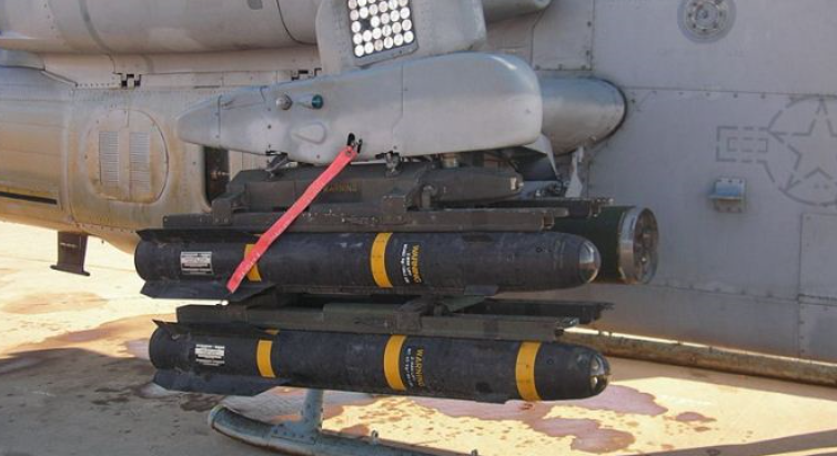 AGM-114 Hellfire-II missiles loaded on a dedicated attack helicopter.