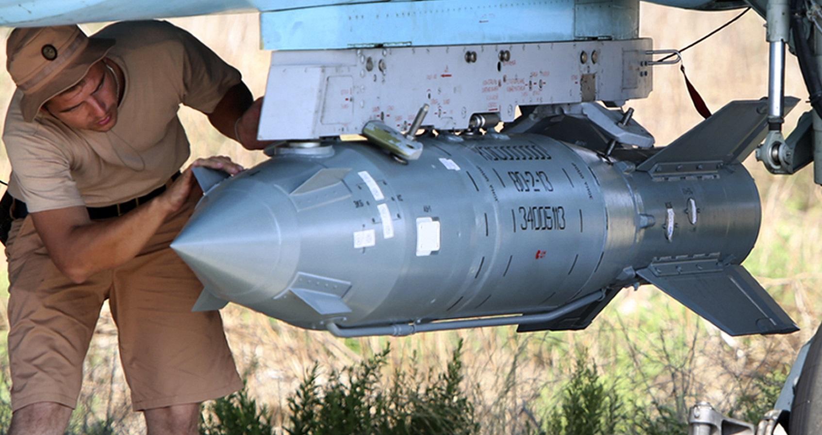 A KAB-500S PGM being inspected by a Russian technician in Syria (AP Photo/Alexander Kots, Komsomolskaya Pravda, Photo via AP)