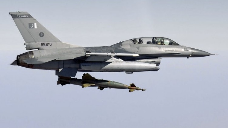 A PAF F-16B dropping a GBU-10 (2000 lb/near-1000 kg) laser-guided bomb.
